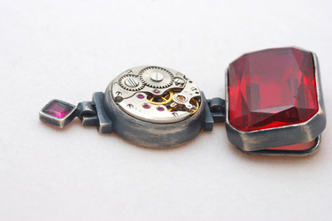 unique pendant with clock and ruby